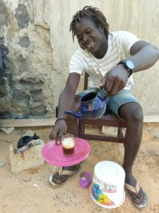 Man-Pours-Tea-Ngor Island Surf Camp.